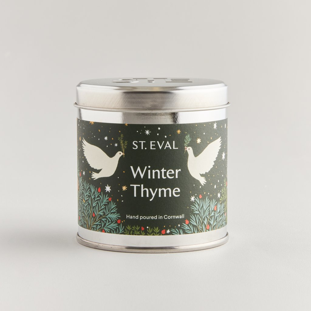 WINTER THYME SCENTED CHRISTMAS TIN CANDLE Whisk yourself away to a world of enchantment with playful characters and festive scents inspired by the magical Christmas season. Spark joy with the sweet, uplifting, and warming winter aromas of our Christmas Scented Tins, featuring beautiful illustrations designed to capture the magic of the season and bring a sparkle to your home. Warm the home this Christmas with Winter Thyme which is a beautiful blend ofrosemary, thyme and winter wood notes.